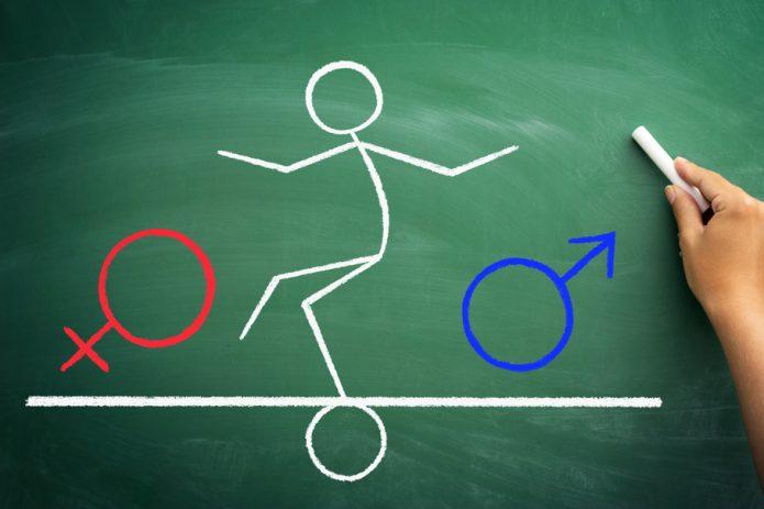 Человек балансирует между мужским и женским